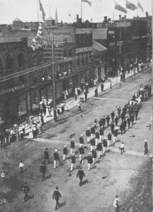 Parade with West side of Queen Street in the background, Postcasr courtesy of the PEI Museum Postcard Collection
