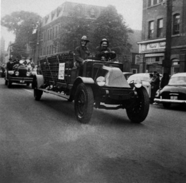 Fire Department Parade traveling east on Kent Street with the Dawson Building in the background, undated, Charlottetown Fire Department Collection