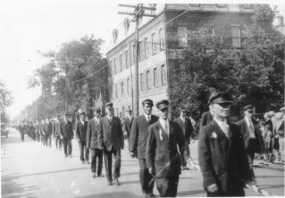 Parade on Kent Street with W.E. Dawson Building in background, undated, Courtesy of the Public Archives and Records Office