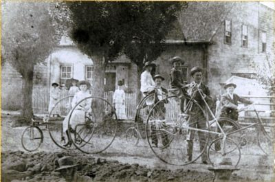 Group Posing With Bicycles c. 1888 - note the two gentlemen at the bottom of the photo digging a trench for the water or sewer line, PARO 2301-94 Photo Courtesy of the Public Archives and Records Office