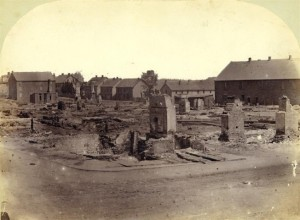 The southeast corner of Pownal and King Street looking toward Water Street after the Great Fire of 1866 <br> Photo courtesy of the Public Archives and Records Office