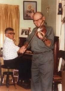 ather Adrien Arsenault and Albin Arsenault playing the harmonium and fiddle respectively, c. 1975 Photo courtesy of Georges Arsenault
