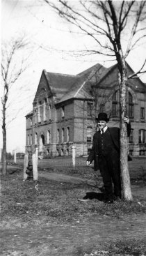 J. Henri Blanchard (1881-1968) in front of/devant le Prince of Wales College (Holland College) <br> Photo: UPEI Special Collections and Archives